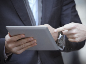 Close-up of a digital tablet in male hands